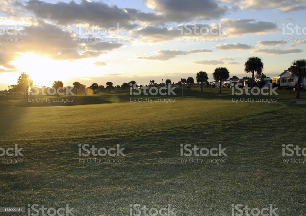 Golf course green morning sky - background stock photo