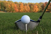 Golf course in autumn  Driver  Golf ball on a tee
