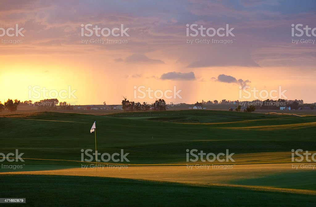Golf Course in Dramatic Evening Light stock photo