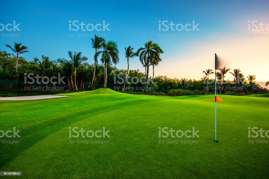 Golf course in the tropical island stock photo