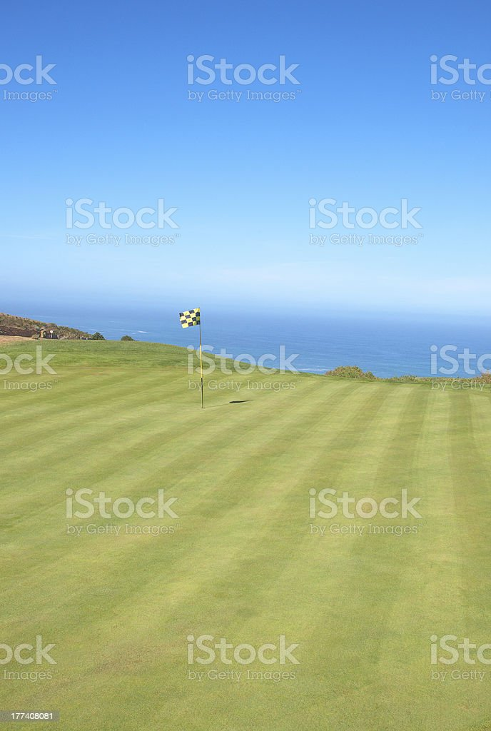 Golf course landscape by the ocean royalty-free stock photo