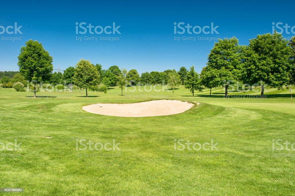 Golf course Landscape green field beautiful blue sky stock photo