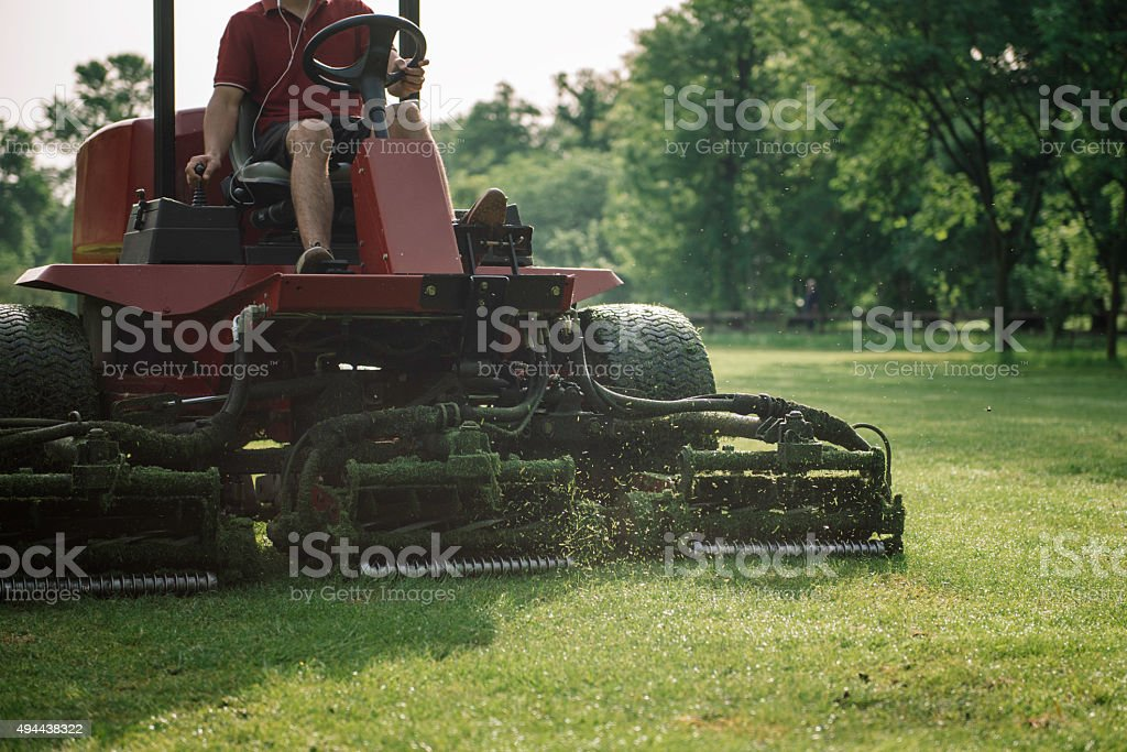 Golf course mowing stock photo
