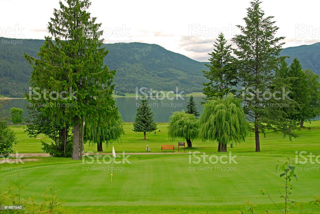 Golf course near the lake royalty-free stock photo