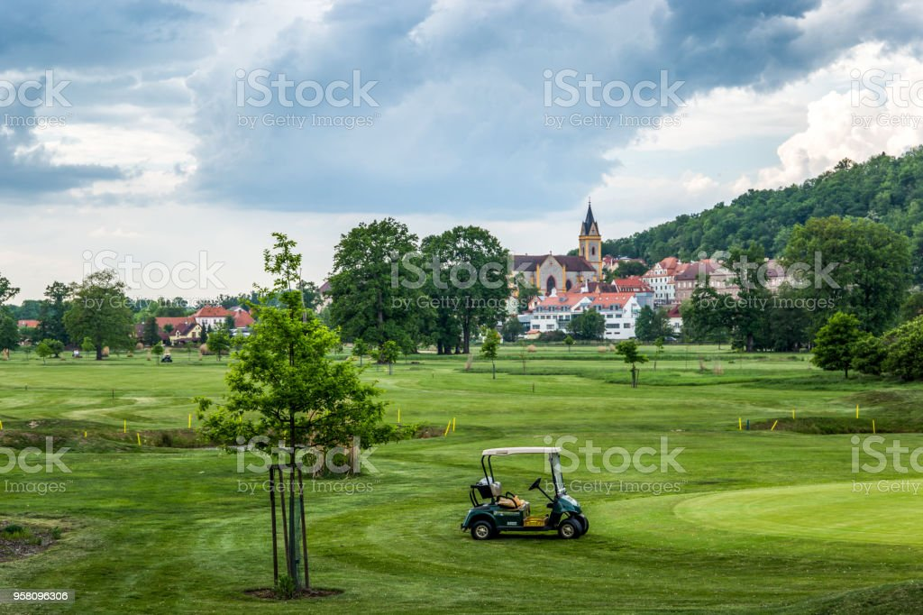 Golf course on a old church background stock photo