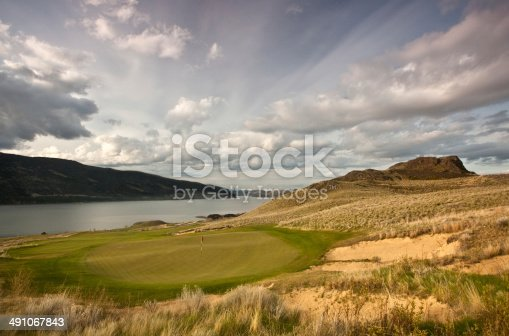 A beautiful golf course in the Thompson Okanagan region of British Columbia. Stunning links style golf course in desert region of Canada. Beautiful spring sky and streaky clouds highlight the scene. Nobody is in the image, taken with canon 5d mark II camera and L series lens.