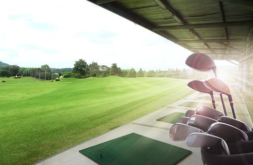 Golf clubs drivers over beautiful golf driving range