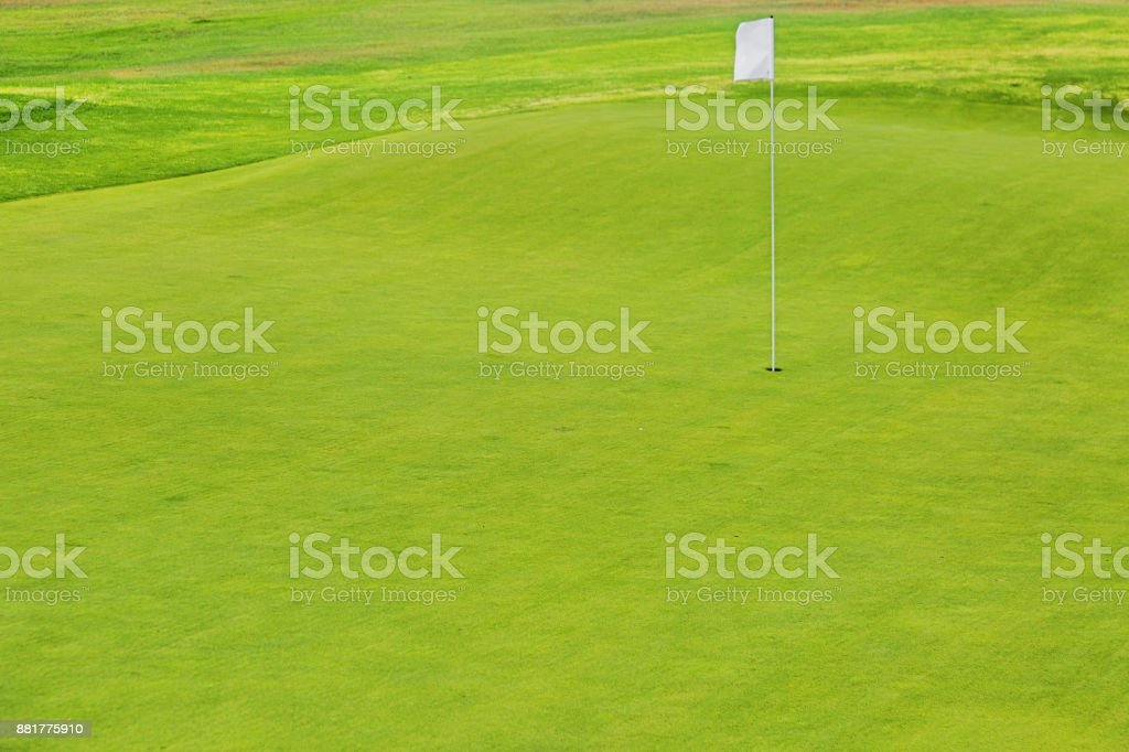 golf course with a white pennant stock photo