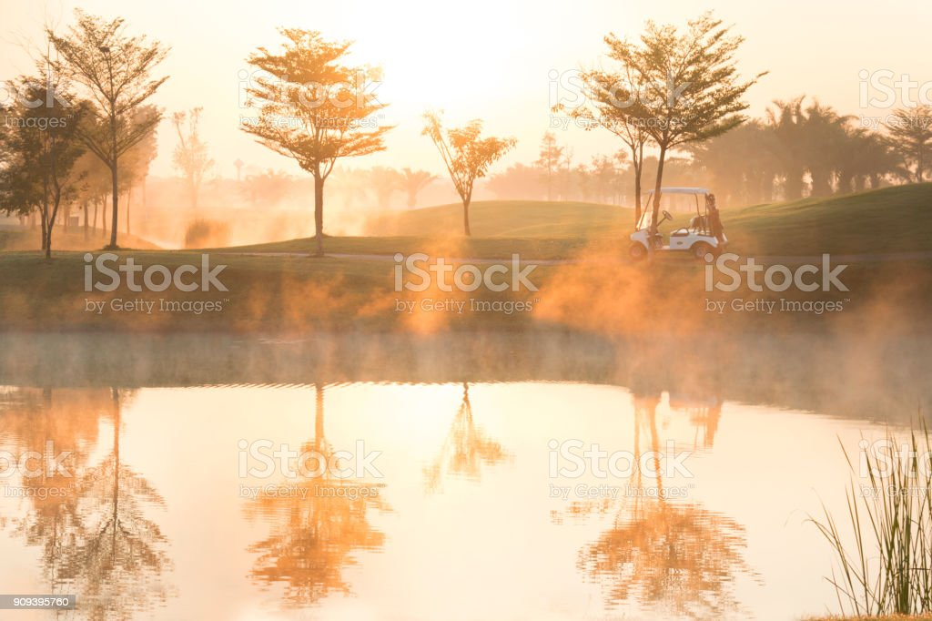 Golf course with foggy in the morning. stock photo