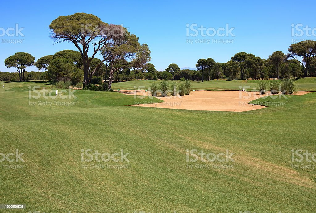 Golf course with sand trap. royalty-free stock photo