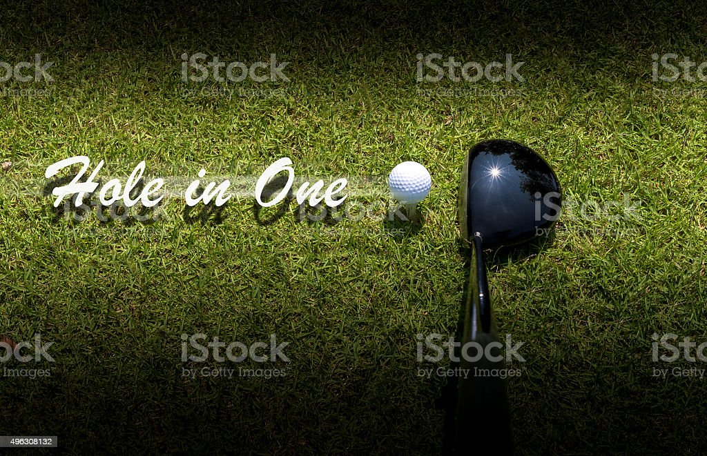 Golf driver driving ball with Hole-in-One caption stock photo