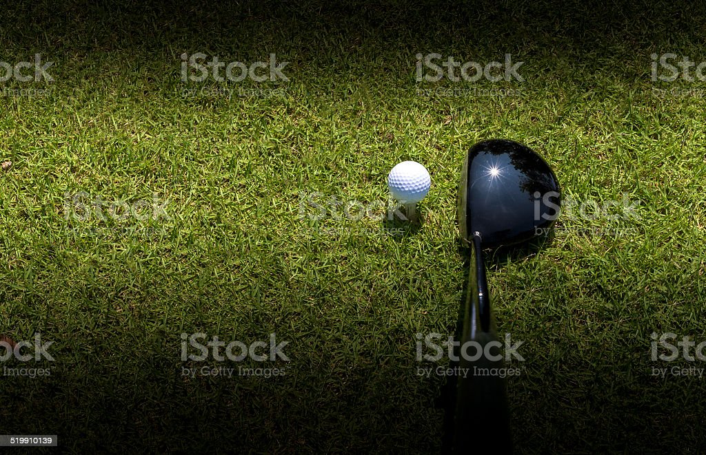 Golf driver driving ball with vignette as abstract stock photo