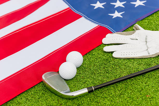golf equipment and an American flag on the lawn stock photo