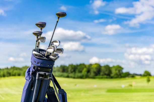 Golf equipment bag standing on a course. stock photo