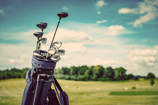 Golf equipment bag standing on a course.