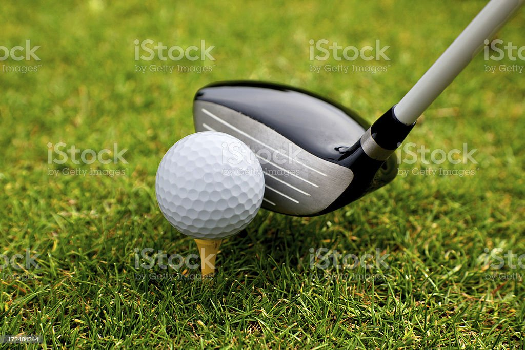 Golf ball on the tees with driver golf stick at the golf area