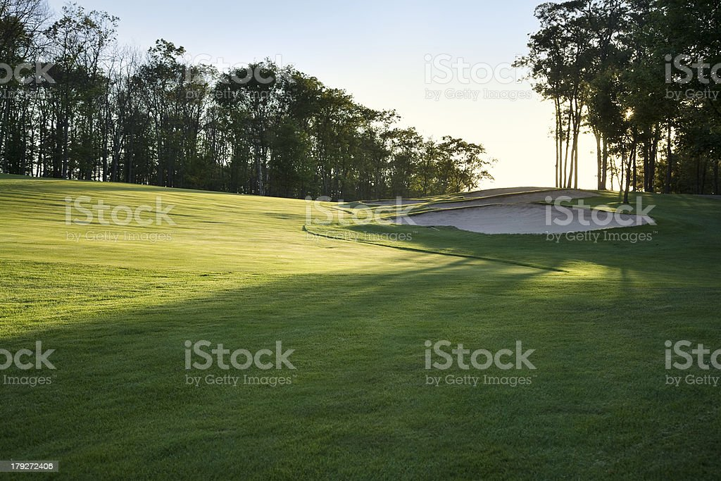 Golf fairway in late afternoon sun - Royalty-free Back Lit Stock Photo