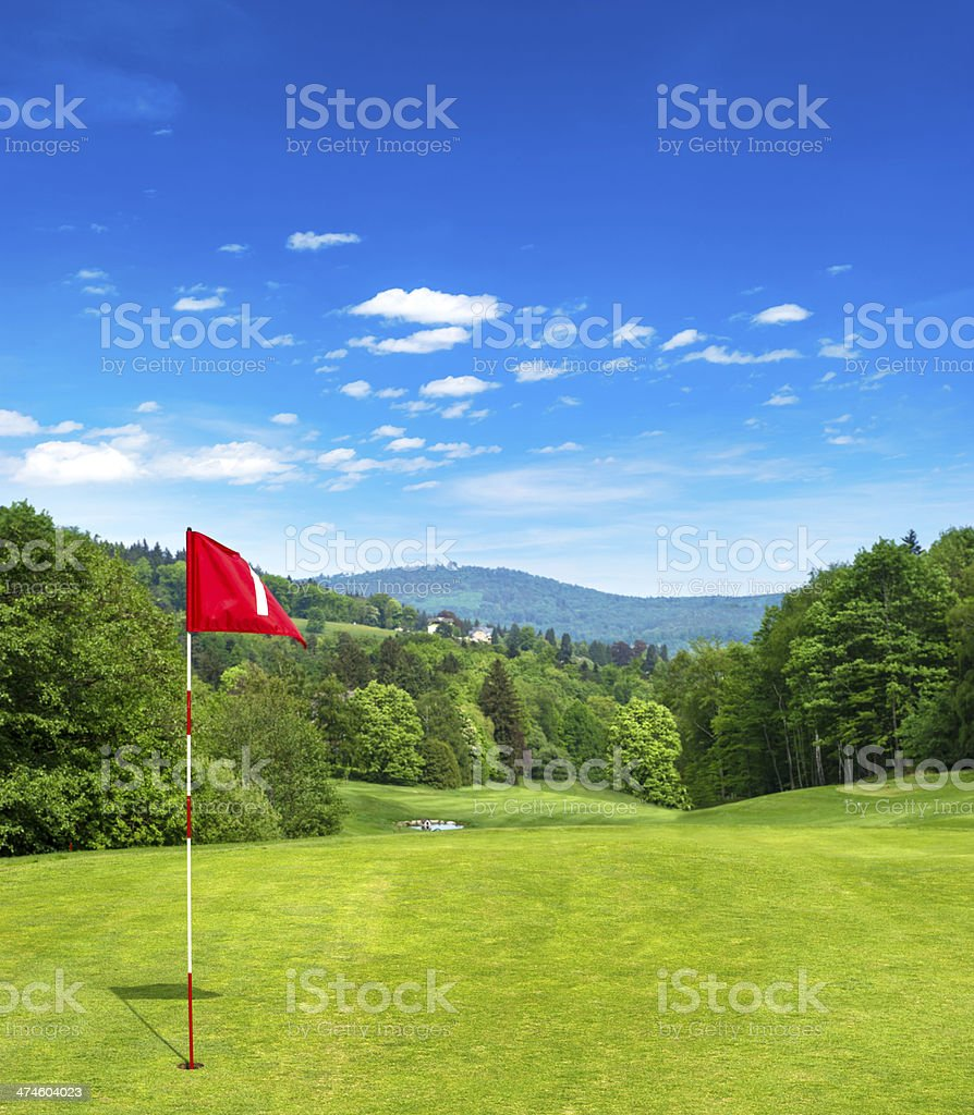 golf field and cloudy blue sky stock photo