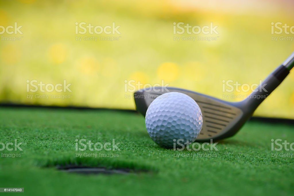 Golf field hole with cross and ball stock photo