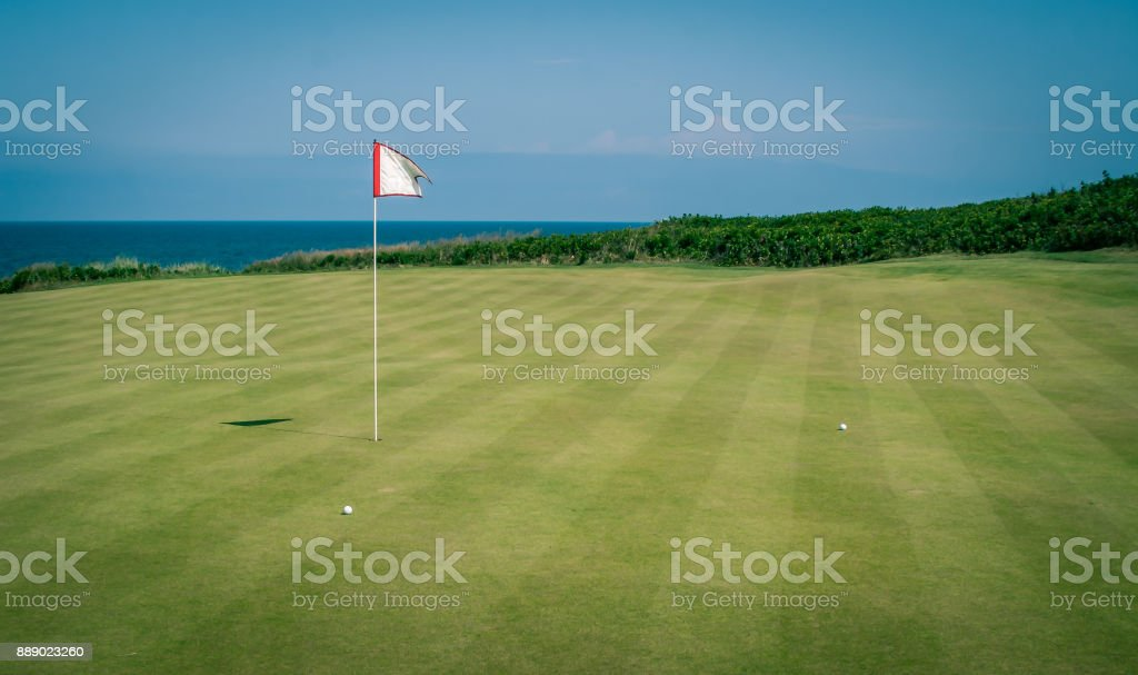 golf flag and green stock photo