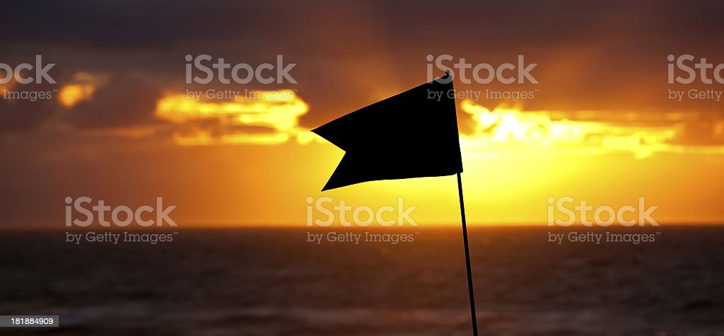 Golf Flag and Ocean Sunset royalty-free stock photo