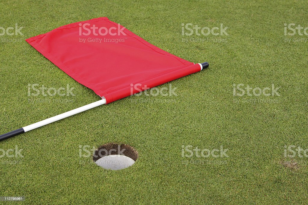 golf flag and putting green stock photo