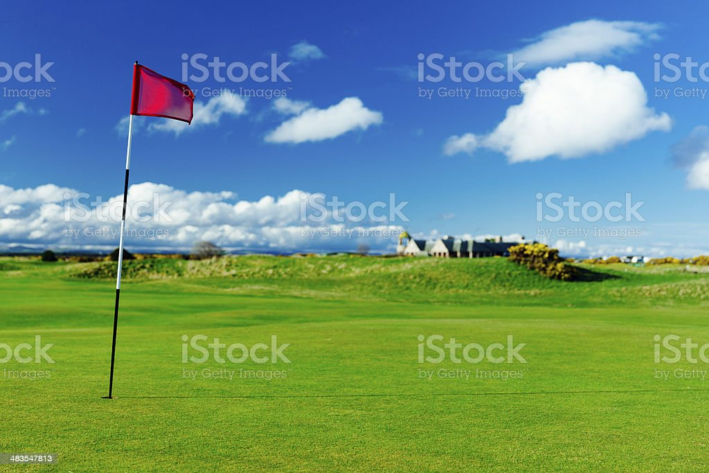 Golf flag on the putting green of the 17th hole on the Old Course at...
