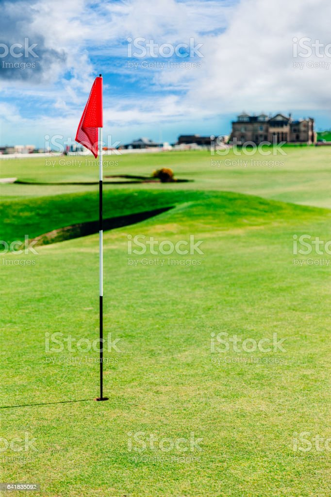 Golf flag on a putting green on the Old Course at St.Andrews in...