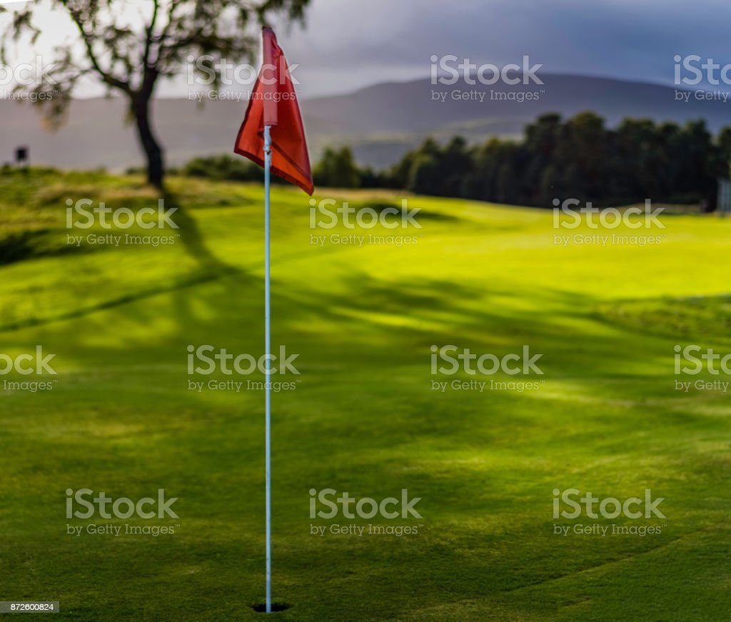 Golf flag on Spey Valley championship golf course in Aviemore at Dalfabour Village Club. stock photo