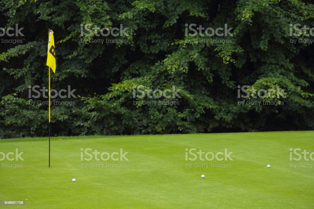 Golf flag on the green grass stock photo
