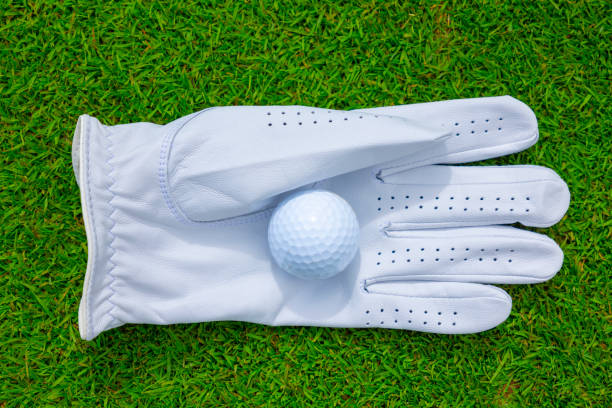 Golf Glove with Golf Ball on the Grass stock photo
