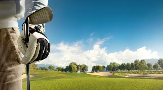 Golf: Golf course with a golf bag