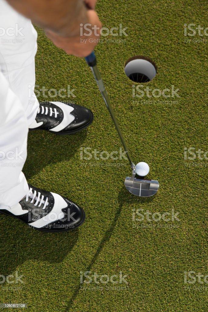 Golf, Golf player putting the golf ball near hole - links golf -...