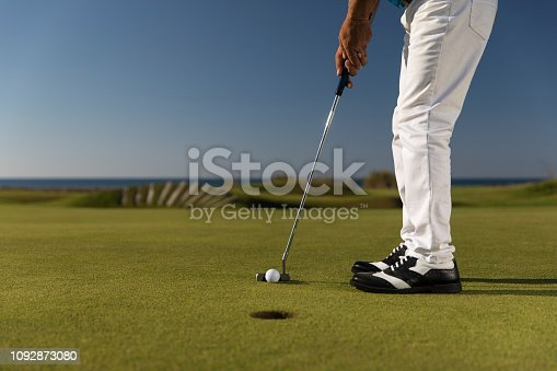 Golf, Golf player putting the golf ball near hole - links golf - Close up
