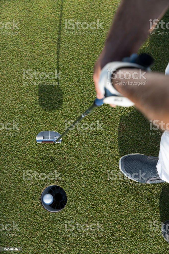 Golf, Golf player putting the golf ball near hole - links golf