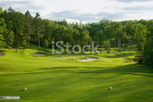 Par 3 hole on golf course in late afternoon sunlightOther golf images: