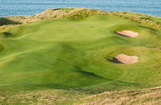 golf green by the sea - county clare stock pictures, royalty-free photos & images