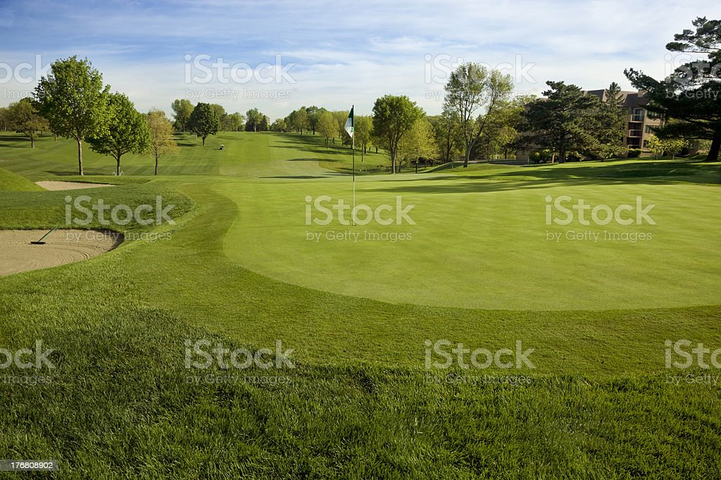 Golf green on sunny morning stock photo