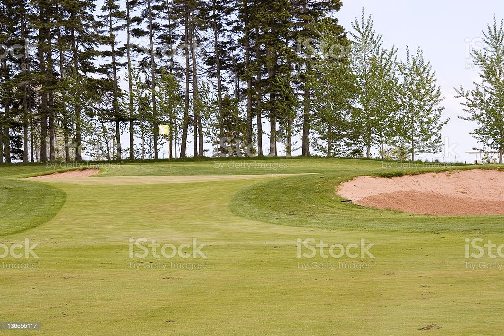 Fairway on a golf course leading to an elevated green