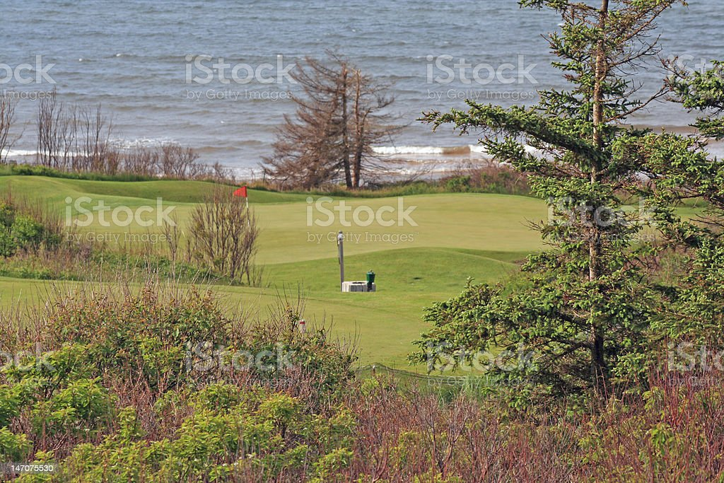 The golf green sits beside the Atlantic ocean