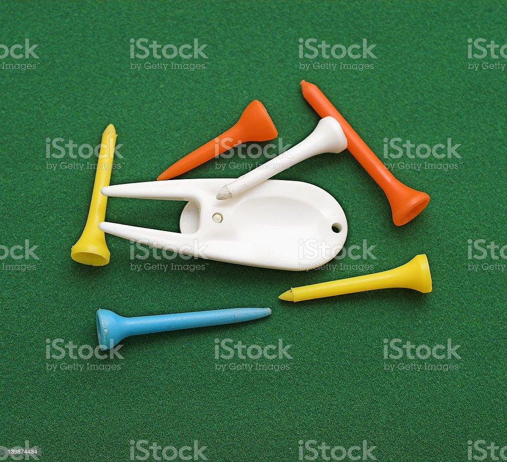 Golf Green Repair Tool and Tees royalty-free stock photo