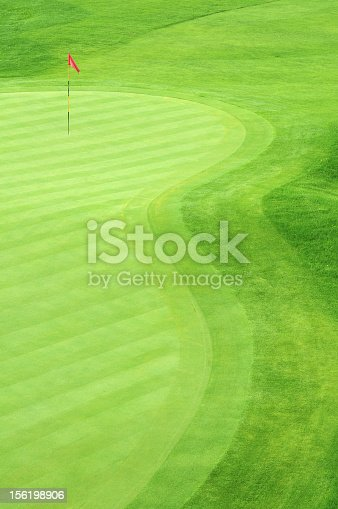 825397576 istock photo Golf green with grass in several green tones 156198906