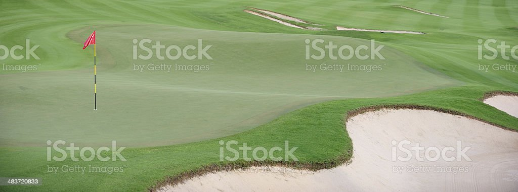 Golf Green with Red Flag stock photo
