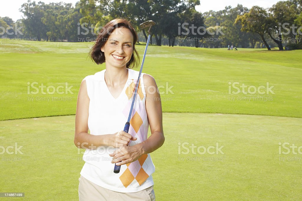 Golf helps her relax royalty-free stock photo