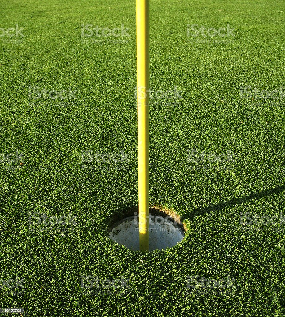 Golf hole and flag royalty-free stock photo
