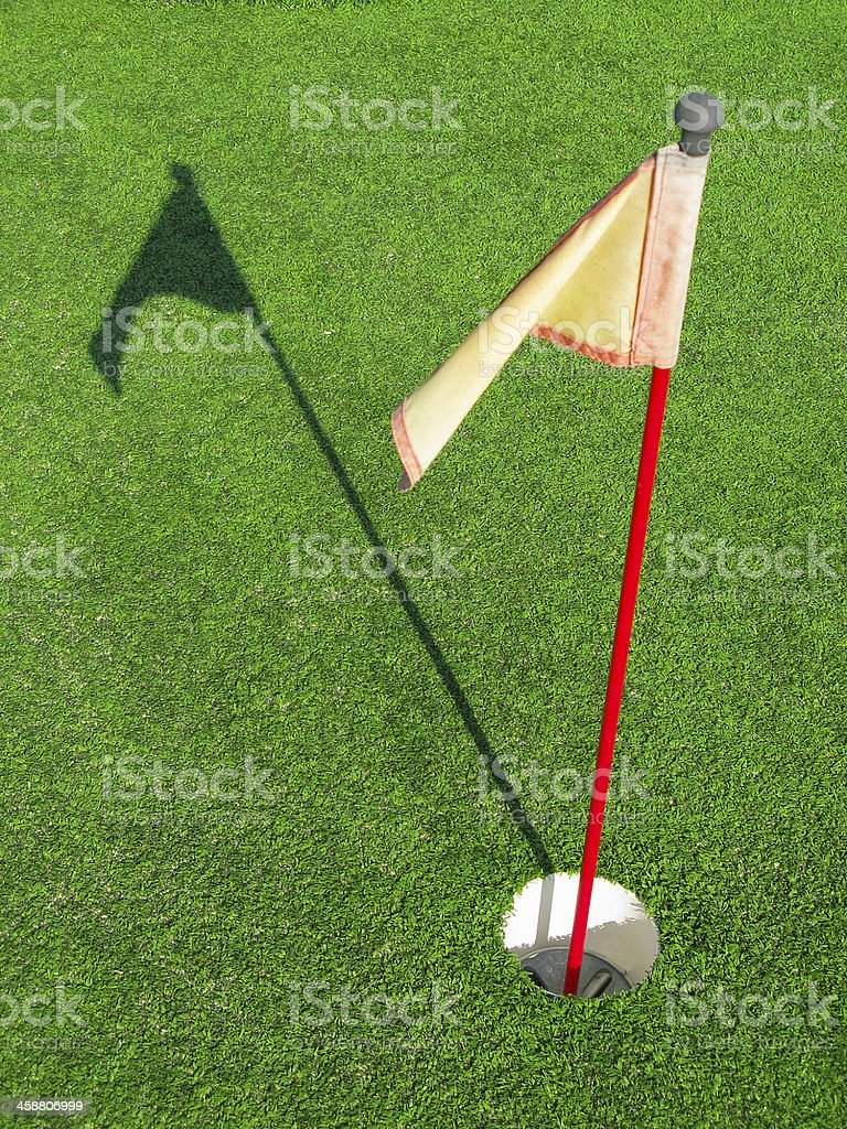 Golf Hole Flag with Shadow royalty-free stock photo