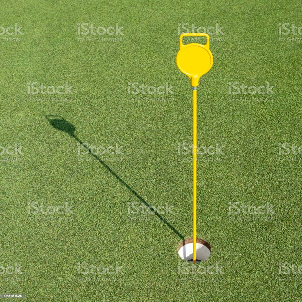 Golf hole in the green field royalty-free stock photo
