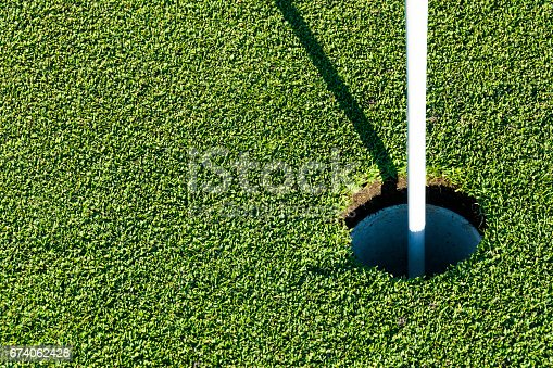 825397576 istock photo Golf hole on green grass of golf course. View of golf hole on green field. 674062428