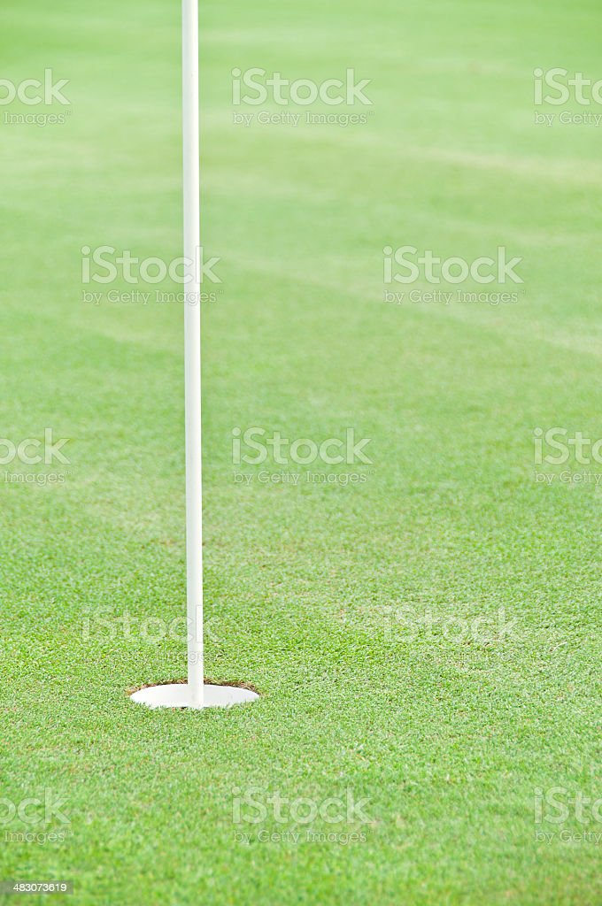 Golf hole with flag stick. royalty-free stock photo