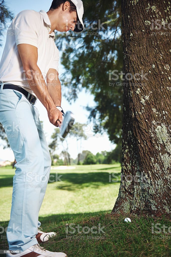 golf in rough stock photo